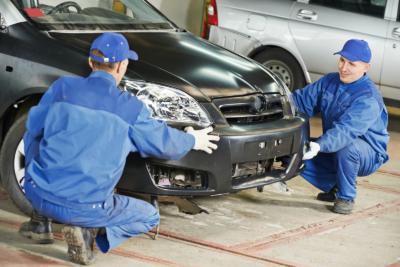 Men Working on Car Bumper