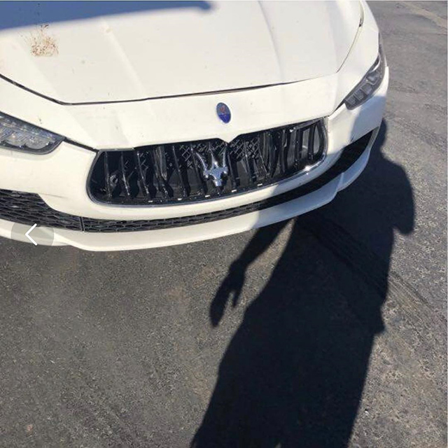 White Car Grill Damaged
